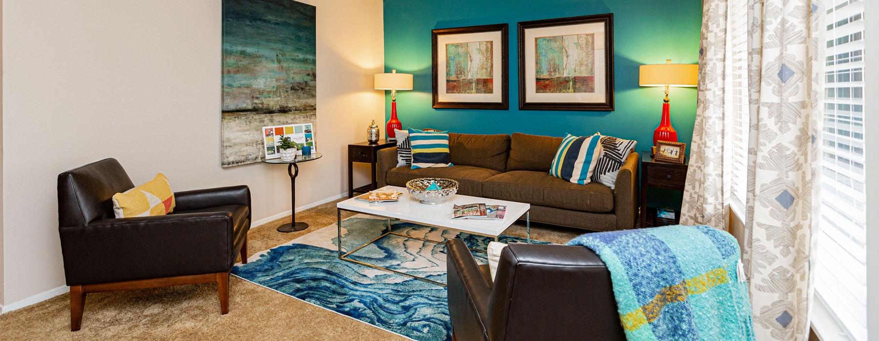 well lit, furnished model living room